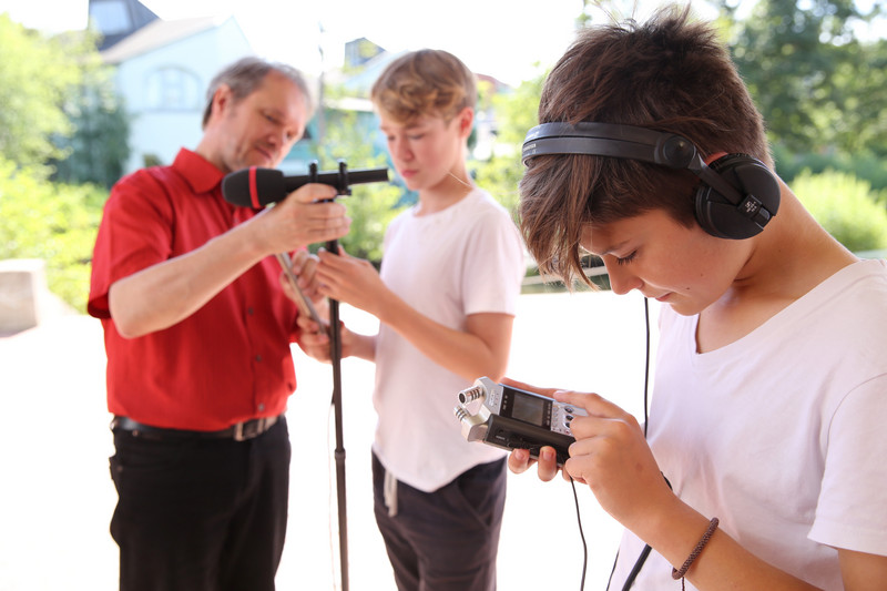 Waldorf students learn how to use radio technology from their teacher