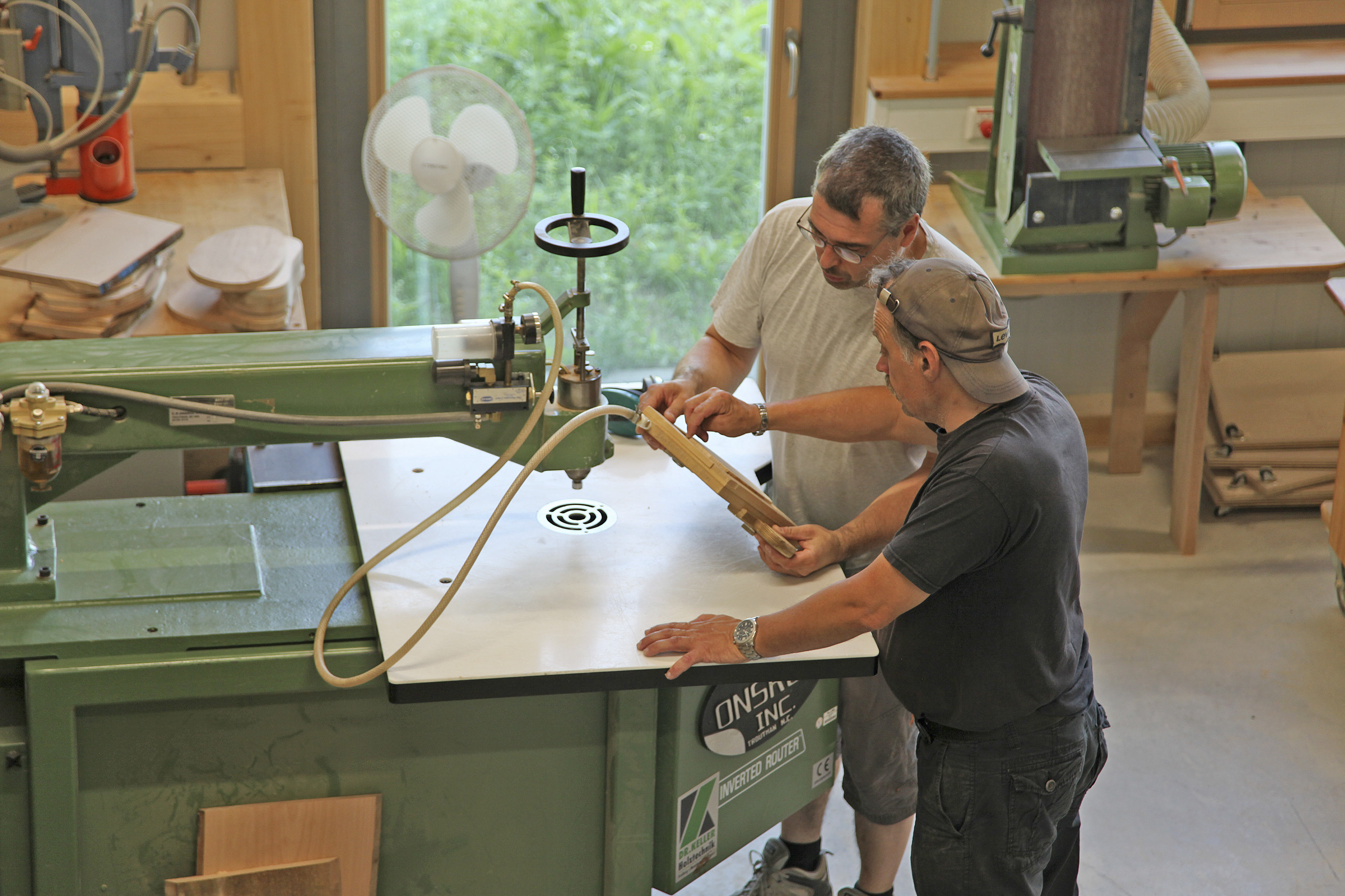 Two men at work in the carpentry workshop