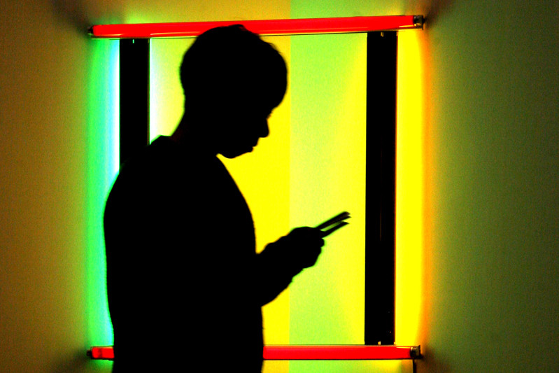 Silouette of a child with smartphone